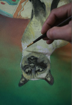painting upside down, cat