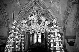 chandelier and crucifix, bone church, czech republic
